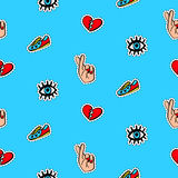 Seamless pattern with fashionable patch badges set, on blue background Royalty Free Stock Photo