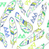 Seamless pattern with feathers in american indians style, vector Royalty Free Stock Image