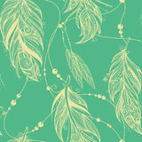 Seamless pattern from feathers of birds Stock Images