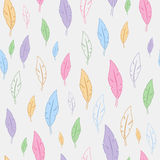 Seamless pattern with feathers of different colors. On a white background Stock Photo