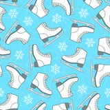 Seamless pattern of figure skates and snowflakes on a white back Royalty Free Stock Image
