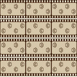 Seamless pattern with film strips and pet paws, brown retro background, vector. Illustration Royalty Free Stock Images