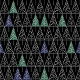 Seamless pattern with fir trees  on background. Soft seamless winter background with fir trees Royalty Free Stock Photo