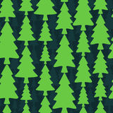 Seamless pattern with fir trees on dark background Royalty Free Stock Photography