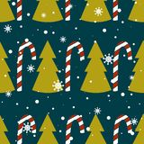 Seamless pattern with fir trees, snow, candy canes vector illustration