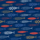 Seamless pattern with fish on a blue background. Vector Royalty Free Stock Photos