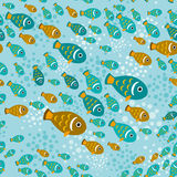 Seamless pattern with fish on a blue water background.  Royalty Free Stock Image