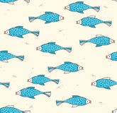 Seamless pattern with fish on a light background Stock Photos