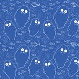 Seamless pattern with fish and white seal animal on blue background Royalty Free Stock Photos