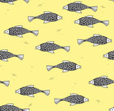 Seamless pattern with fish on a yellow background Stock Photos