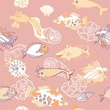 Seamless pattern  with   fishes and cockleshells Royalty Free Stock Images