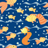 Seamless pattern with a fishes Royalty Free Stock Photos