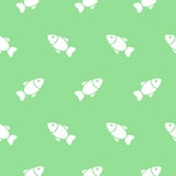 Seamless pattern with fishes on green. Vector illustration. Royalty Free Stock Images