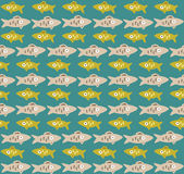 Seamless pattern with fishes rows. Cute seamless pattern with yellow and gray rows of fishes Stock Images