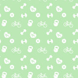 Seamless pattern fitness icons on green Stock Photography