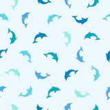 Seamless pattern - flat blue dolphins Royalty Free Stock Image