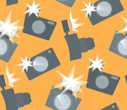 Seamless pattern with flat cameras with flash. Vector background for your creativity Stock Photo