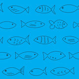 Seamless pattern with floating fish. A flock of swimming fish.  Seamless pattern. Hand drawn design Royalty Free Stock Images