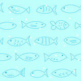 Seamless pattern with floating fish. A flock of swimming fish.  Seamless pattern. Hand drawn design Stock Photos