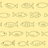 Seamless pattern with floating fish. A flock of swimming fish.  Seamless pattern. Hand drawn design Stock Images