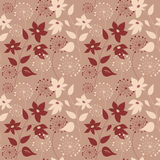 Seamless pattern with flowers on a beige background Royalty Free Stock Photography