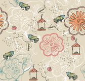 Seamless pattern. With flowers and birds Stock Images