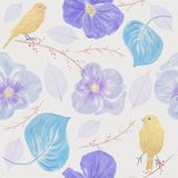 Seamless  pattern with flowers and birds. Seamless floral pattern with yellow birds and flowers. Endless texture for your design Royalty Free Stock Photo