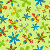 Seamless pattern with flowers on a green background Stock Image