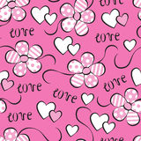 Seamless pattern with flowers and hearts. On a pink background Stock Images