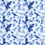 Seamless pattern with flowers, leaves, and birds. Stock Images