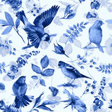 Seamless pattern with flowers, leaves, and birds. Stock Photos
