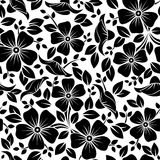 Seamless pattern with flowers and leaves. Royalty Free Stock Images