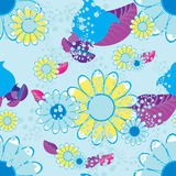 Seamless pattern of flowers and leaves on a blue background. vec Stock Photos