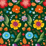 Seamless pattern of flowers and leaves on a dark background