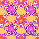 Seamless pattern flowers net violet pansies on an orange  Stock Photography