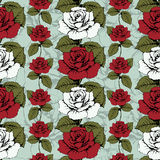 Seamless pattern of flowers roses. Red and white roses Woven, ornate. Blue background with flowery patterns. Twisted buds, leaves, Stock Photo