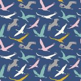 Seamless pattern of flying birds. Stock Photos
