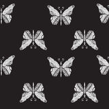 Seamless pattern with flying butterflies on a black background Royalty Free Stock Photos