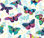 Seamless pattern with flying colorful butterflies and flowers Royalty Free Stock Image