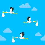 Seamless pattern of flying storks carrying a baby. In a white bundle in their beaks against a blue cloudy sky, square format vector illustration Royalty Free Stock Image