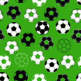 Seamless pattern with football ball on green background. Vector illustration Stock Photography