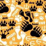 Seamless pattern with footprints and bones royalty free stock photography