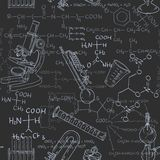 Seamless pattern of the formulas on the chemicals and equipment Stock Photos
