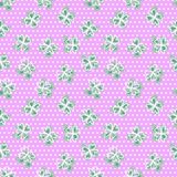 Seamless pattern with four-leaf clover. Background with Scandinavian design. Green, pink, white polka dot Stock Images