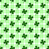 Seamless pattern with four leaves green clovers Stock Image