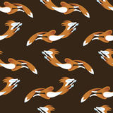 Seamless pattern fox jumping on brown color background Stock Photography