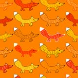 Seamless pattern with foxes. Orange seamless pattern with foxes. Cute animals drawn by hand in cartoon style Royalty Free Stock Photos