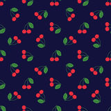 Seamless pattern of fruit - cherries. On a dark background Royalty Free Stock Images