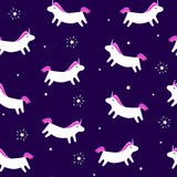 Seamless pattern with fun unicorn and stars with rays on violet background. Merry Christmas ornament for textile and wrapping. Vec Royalty Free Stock Images