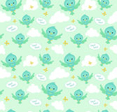 Seamless pattern with funny cartoon birds. Endless background. Royalty Free Stock Images